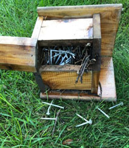 bird box open to find nest made of many nails