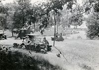 two boys at a campsite with canvas tent in 1941