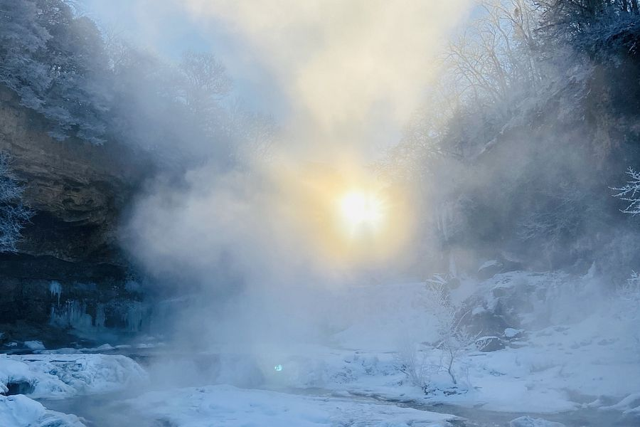Sun peeking through the falls at Willow River State Park during a cold winter day! - Photo credit: DNR