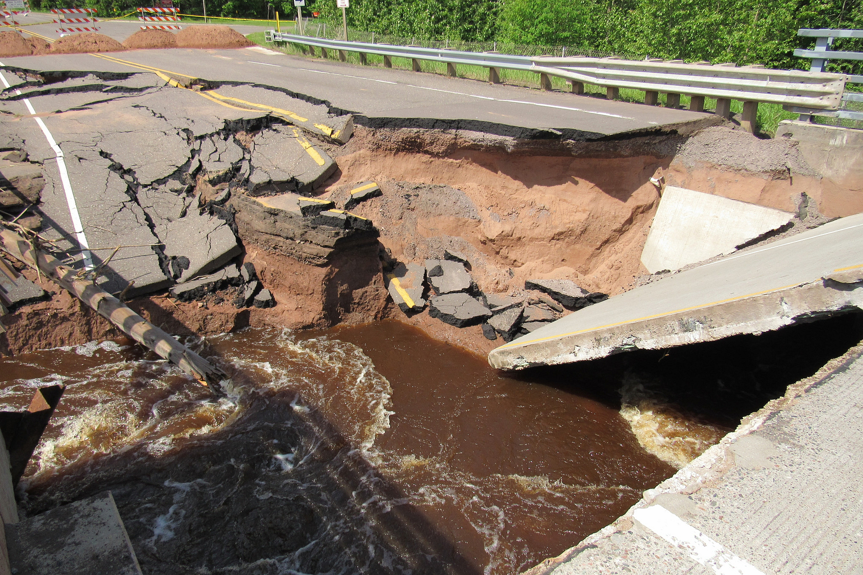 Photo of washed out bridge on Highway 35 near Pattison State Park