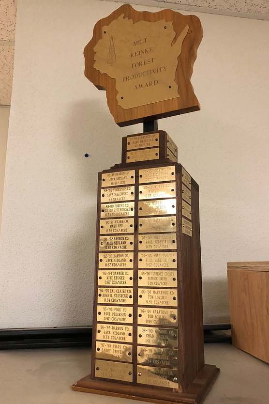 Trophy with state of Wisconsin cutout on top and gold plates down the front
