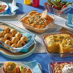 Littles 5-piece Bakeware Set with food in each piece on othe table