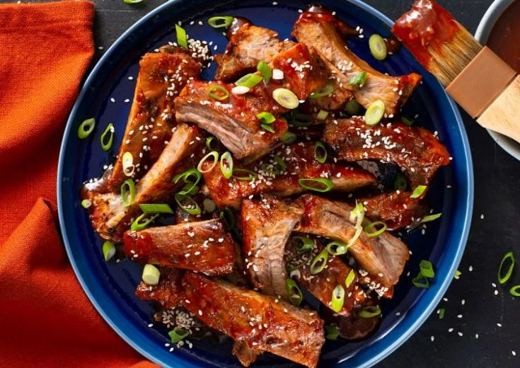 Baby Back Ribs in a bowl with sauce