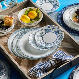 Veranda 18-piece Dinnerware Set on the table in with food on the side