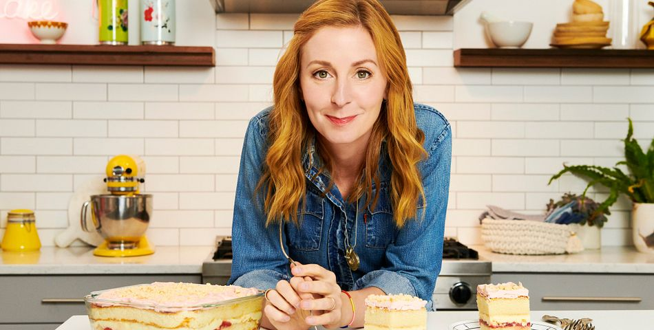 Christina Tosi in front of her cake made in a Pyrex Deep 8x8 baking dish.