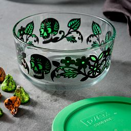 Skull Garden 4 Cup Glass Food Storage Container with Green Lid with candy beside bowl