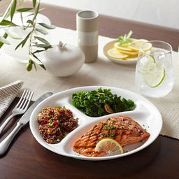 "Winter Frost White 10.25"" Divided Plate on the table with salmon and side dishes"