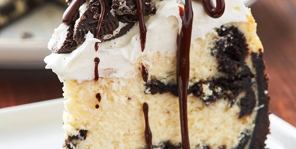 Oreo Cheesecake on plate with chocolate drizzle on top