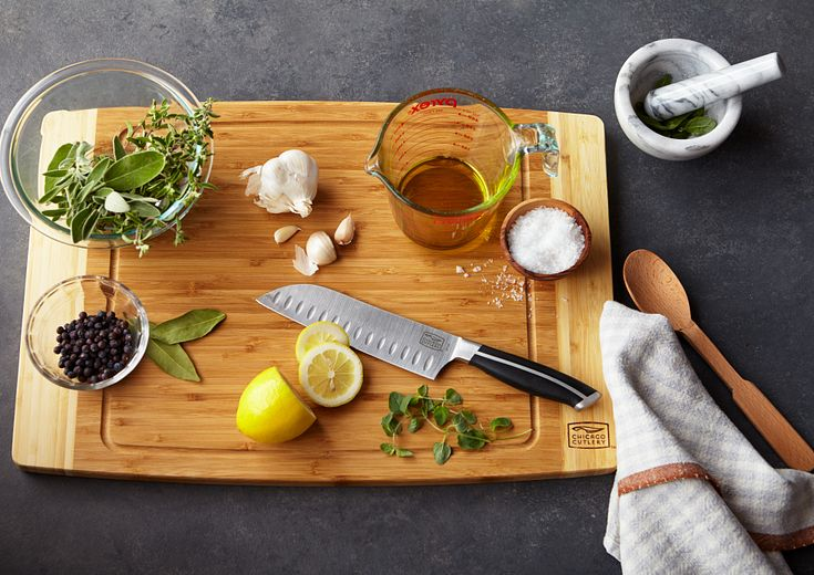 Chicago Cutlery cutting board with herbs and lemons being sliced