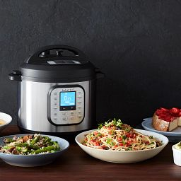 Instant Pot Duo Nova 10-quart Multi-Use Pressure Cooker shown with 3 dishes of various foods