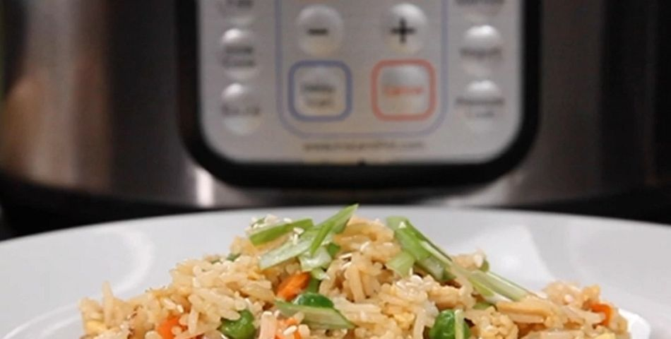 Chicken fried rice in a bowl infrom of an instant pot