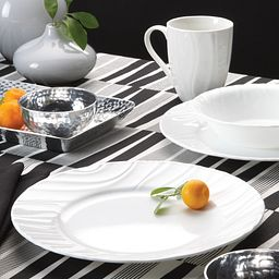 Swept Embossed 16-pc Dinnerware Set on the table