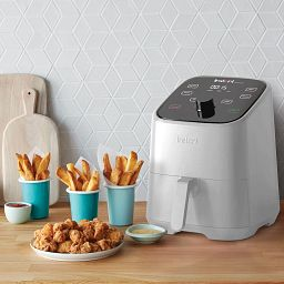 Instant™ Vortex™ Mini 2-quart White Air Fryer on the counter with food