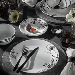 Inked Poppy 18-piece Dinnerware Set, Service for 6 on the table with flowers and fruit