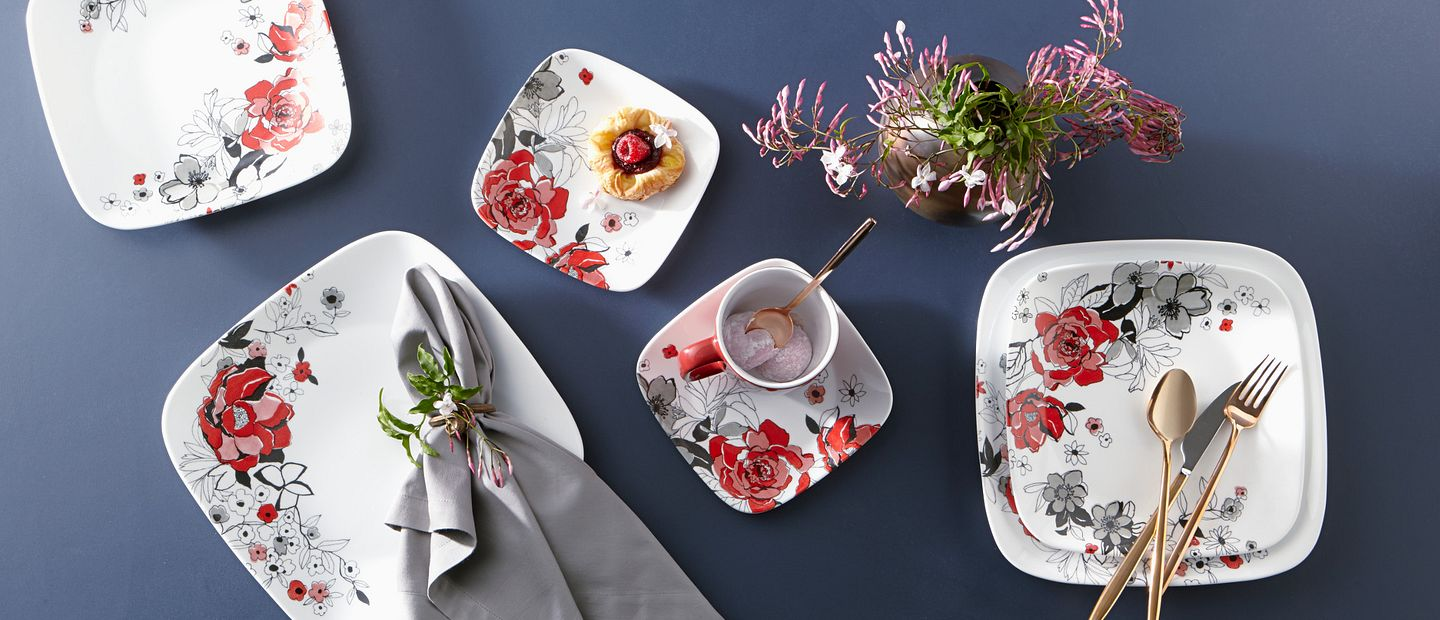 Chelsea Rose dinnerware on table with flowers