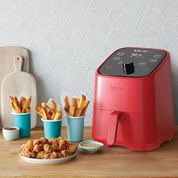 Instant™ Vortex™ Mini Red 2-quart Air Fryer, side view on the counter with fries