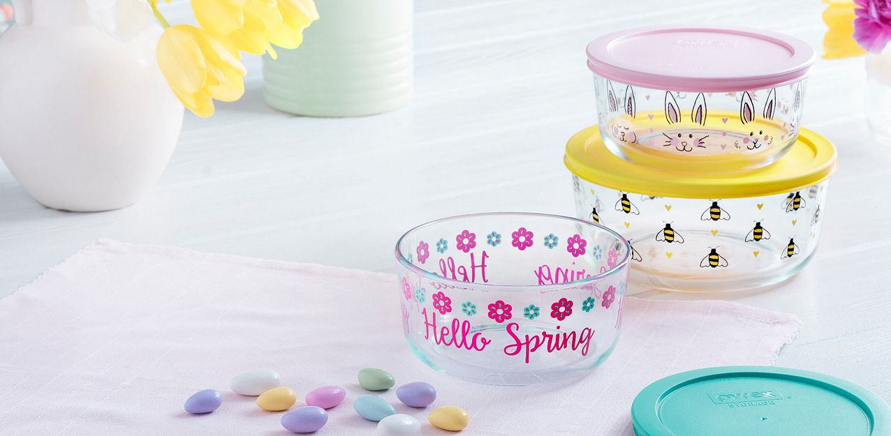 Pyrex decorated glass storage spring collection featuring bees, bunnies and flower patterns