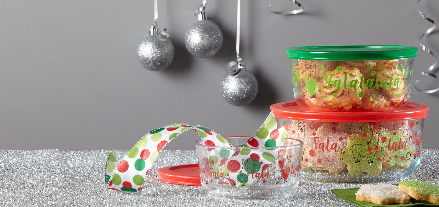 Pyrex decorated storage featuring a holiday llama pattern shown holding cookies.