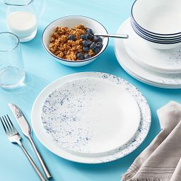 Indigo Speckle 16-pc Dinnerware on the table with food
