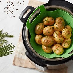 Instant Pot Healthy Bite Silicone Steamer lifting potatoes out of Instant Pot