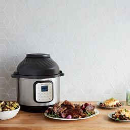Instant Pot Duo Crisp and 8-quart Air Fryer shown with food on the counter
