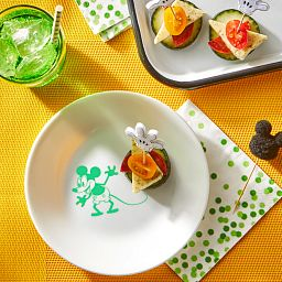 "6.75"" Appetizer Plate: Mickey Mouse™ - Classic Mickey Mouse with food and drink on the table"