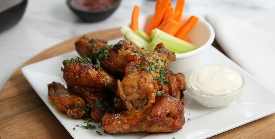 Honey BBQ Wings on plae with carrots and dipping sauce