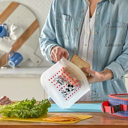 Disney Mickey Mouse Medium Silicone Storage Bag being used to put a sandwich inside