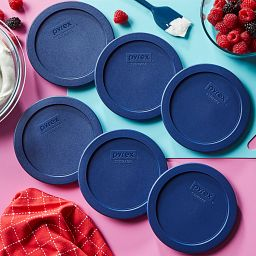 4-cup Round Dark Blue Plastic Lids, 6-pack shown the table