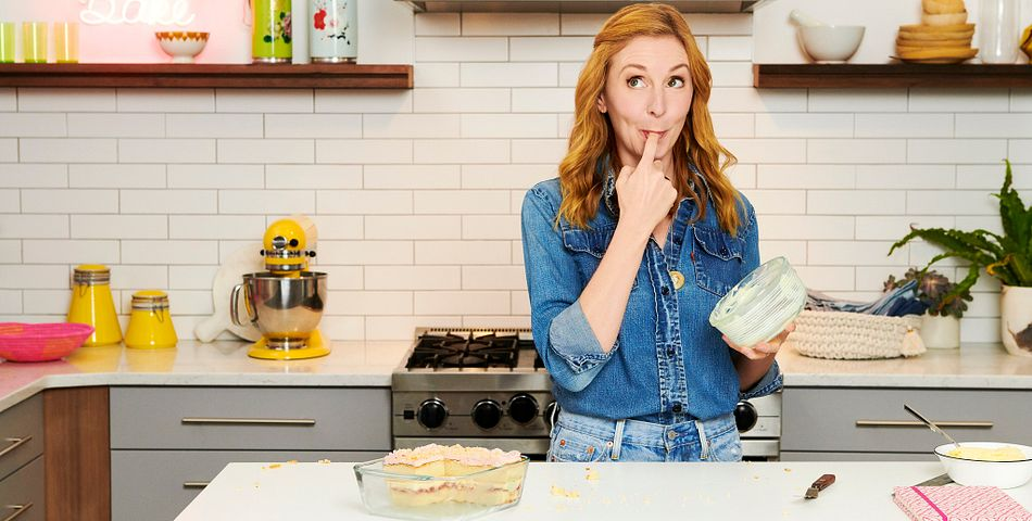 Christina Tosi licking frosting off of her cake