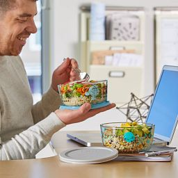 Food being enjoyed at the computer being eaten out of the Star Wars™ Decorated 4-pc Storage Set
