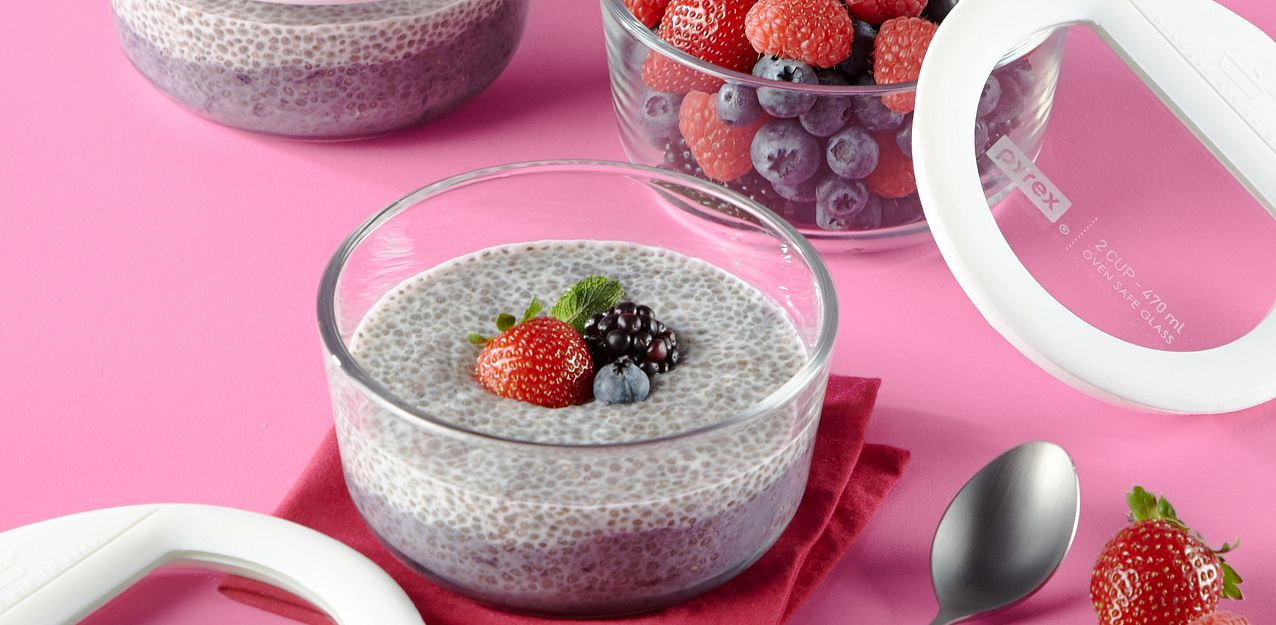 Pyrex Ultimate glass food storage containers showing fruit and chia pudding