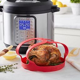 Instant Pot Essential Serving Rack with chicken inside with Instant Pot next to it