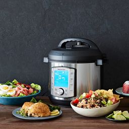 Instant Pot® Duo Evo™ Plus 8-quart Multi-Use Pressure Cooker shown with 3 various bowls of food on counter