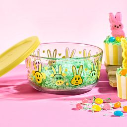 Every Bunny 7-cup Food Storage Container with Yellow Lid on the table