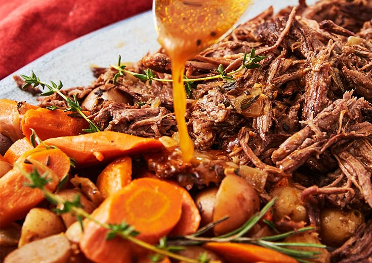 Pot Roast with gravy and carrots on a plate