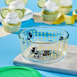 Pyrex Mickey Mouse Oh Boy! 4 cup decorated storage with cupcakes in background