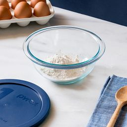 1-quart Mixing Bowl with Dark Blue Lid on the table with flour in the bowl