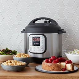 Instant Pot Duo 8-quart Multi-Use Pressure Cooker shown with cheesecake and other foods in plates on counter