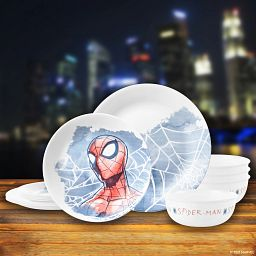Marvel Spider-Man 12-piece Dinnerware Set on counter with city lights in the background