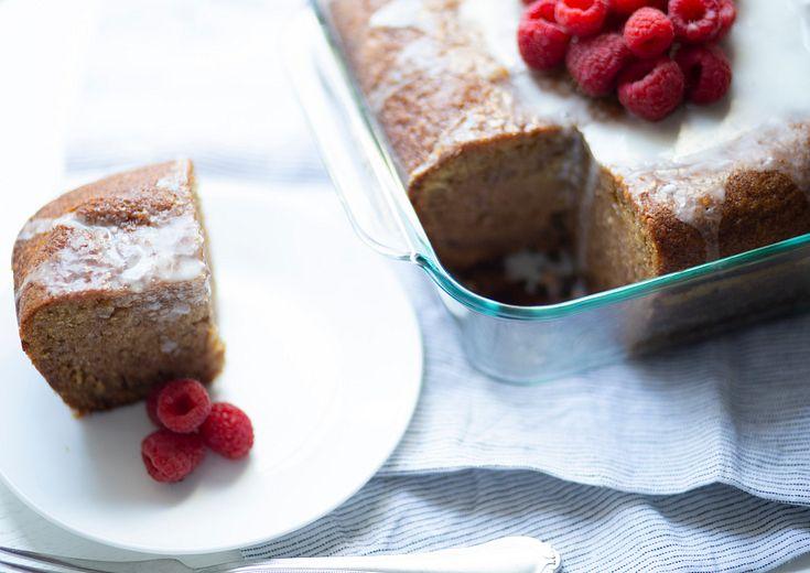 Raspberry jam cake shown in a pyrex deep 8 x 8 baking dish.