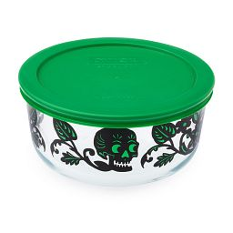 Skull Garden 4 Cup Glass Food Storage Container with Green Lid on the dish