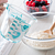 Love 2 Cup Turquoise Measuring Cup Pouring Flour into Mixing Bowl