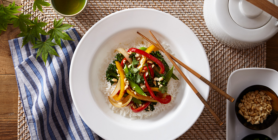 Stir fry served in a large dazzling white corelle meal bowl