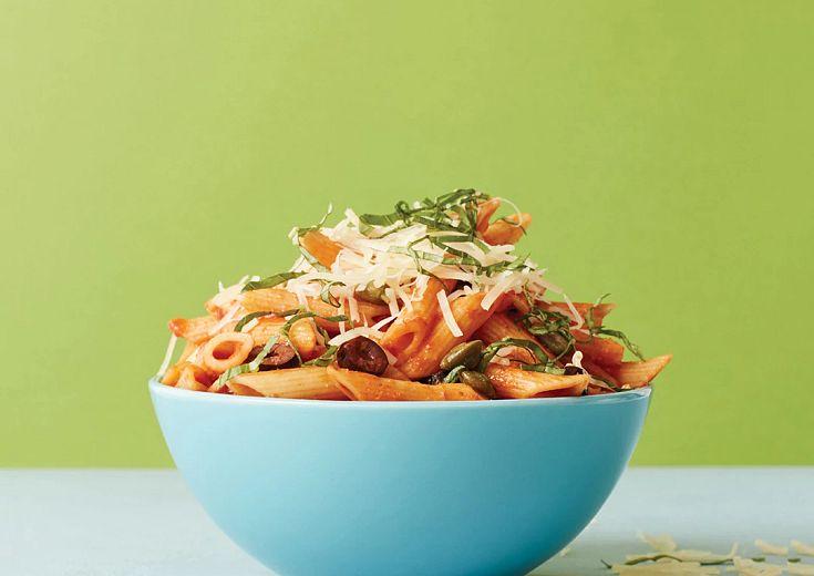 Pasta Puttanesca served in deep dish bowl
