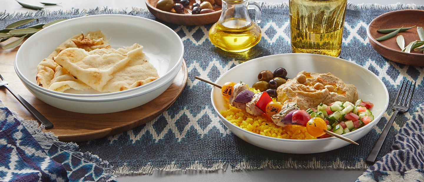 Corelle Bowls with Mediterranean food on table.