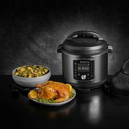 Instant Pot® Pro™ Crisp & Air Fryer 8-quart Multi-Use Pressure Cooker and Air Fryer shown with chicken and vegetables
