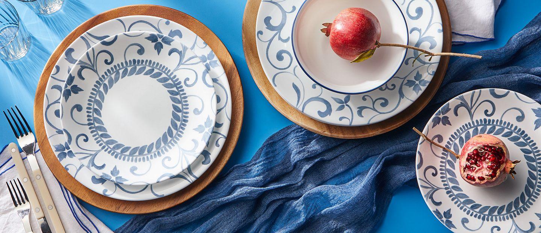Artemis 12 piece dinnerware set featuring blue flower pattern with swirls