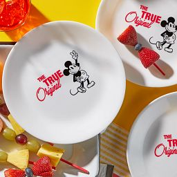 "8.5"" Salad Plate: Mickey Mouse™ - The True Original on the table with appetizers"