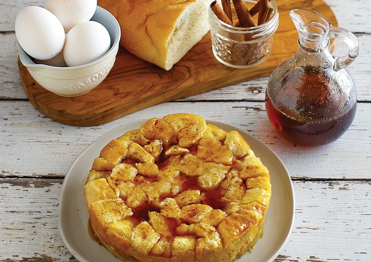 Overnight French Toast Casserole on a plate with syrup on the side